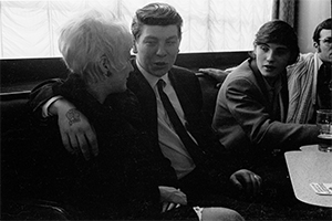 Black and white photograph of trawlermen and girlfriend in Hull pub 1971.